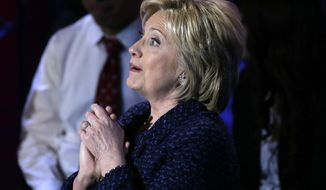 Democratic presidential candidate, Hillary Clinton gestures as she speaks during the Brown & Black Forum, Monday, Jan. 11, 2016, in Des Moines, Iowa. (AP Photo/Charlie Neibergall)