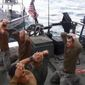 American Navy sailors were held by the Iranian Revolutionary Guards but released Wednesday. The images counter President Obama's narrative that it was diplomacy alone that returned the sailors. (Associated Press)