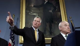 New York Mayor Bill de Blasio, left, and New York City Police Commissioner William Bratton address a news conference in New York's City Hall, in front of a painting of Alexander Hamilton, Tuesday, Jan. 12, 2016. (AP Photo/Richard Drew)