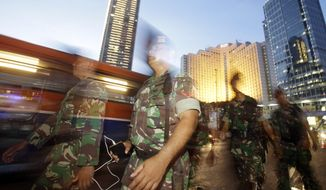 Indonesian soldiers are deployed to secure New Year celebrations in Jakarta, Indonesia, on Dec. 31. (Associated Press)