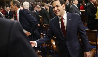 Republican presidential candidate Sen. Marco Rubio, R-Fla., arrives for the State of the Union address to a joint session of Congress by President Barack Obama on Capitol Hill in Washington, Tuesday, Jan. 12, 2016. (AP Photo/Evan Vucci)