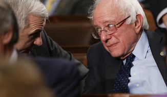 Democratic presidential candidate Sen. Bernie Sanders, I-Vt., talks with Sen. Jack Reid, D- R.I., before President Barack Obama delivers the State of the Union address to a joint session of Congress on Capitol Hill in Washington, Tuesday, Jan. 12, 2016. (AP Photo/Evan Vucci)