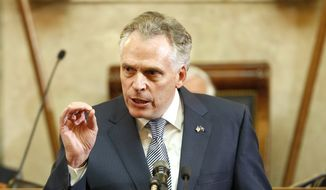 Virginia Gov. Terry McAuliffe gestures as he delivers his State of the Commonwealth Address before a joint session of the 2016 Virginia Assembly at the Capitol in Richmond, Va., Wednesday, Jan. 13, 2016. (AP Photo/Steve Helber)