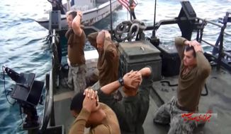 This frame grab from a Jan. 12, 2016, video by the Iranian state-run IRIB News Agency, shows detention of American Navy sailors by the Iranian Revolutionary Guards in the Persian Gulf, Iran. (IRIB News Agency via AP) ** FILE **