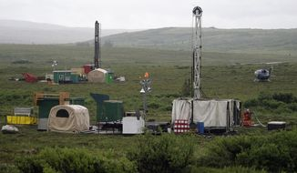 In this July 13, 2007, file photo, workers with the Pebble Mine project test drill in the Bristol Bay region of Alaska near the village of Iliamma. (AP Photo/Al Grillo, File)