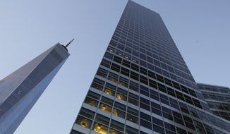 Goldman Sachs headquarters (right) neighbors One World Trade Center in New York. (Associated Press)