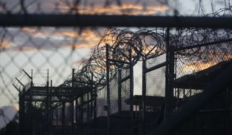 Dawn arrives at the now closed Camp X-Ray, which was used as the first detention facility for al Qaeda and Taliban militants who were captured after the Sept. 11 attacks, at Guantanamo Bay Naval Base, Cuba. (Associated Press)