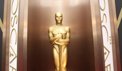 In this March 2, 2014 file photo, an Oscar statue is displayed at the Oscars at the Dolby Theatre in Los Angeles.  The 88th Academy Awards nominations will be announced on Thursday, Jan. 14, 2016, at 5:30 a.m. PST in the Academy's Samuel Goldwyn Theater in Beverly Hills, Calif. The Oscars will be presented on Feb. 28, 2016, in Los Angeles. (Photo by Matt Sayles/Invision/AP, File)