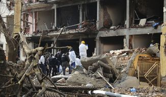 Turkish police officers and members of rescue services work at a destroyed police station in Cinar, in the mostly Kurdish Diyarbakir province in southeastern Turkey, Thursday Jan. 14, 2016. Kurdish rebels detonated a car bomb at a police station in southeastern Turkey, then attacked it with rocket launchers and firearms, killing several people, including civilians, the governor's office said Thursday. (AP Photo/Mahmut Bozarslan)