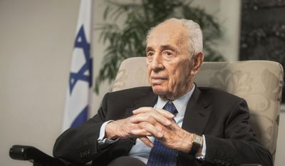 Former Israeli President Shimon Peres speaks during an interview with The Associated Press in Jerusalem, in this Nov. 2, 2015, file photo. He was rushed to hospital Thursday, Jan. 14, 2016, following chest pains and underwent a heart procedure, his spokeswoman said. (AP Photo/Dan Balilty, File)