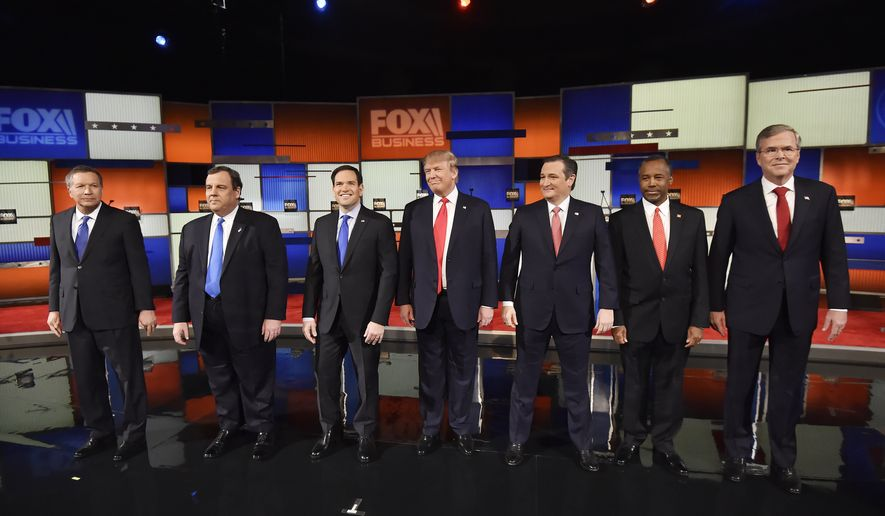 Republican presidential candidates, from left, Ohio Gov. John Kasich, New Jersey Gov. Chris Christie, Sen. Marco Rubio, R-Fla., businessman Donald Trump, Sen. Ted Cruz, R-Texas, retired neurosurgeon Ben Carson and former Florida Gov. Jeb Bush take the stage before the Fox Business Network Republican presidential debate at the North Charleston Coliseum, Thursday, Jan. 14, 2016, in North Charleston, S.C. (AP Photo/Rainier Ehrhardt)