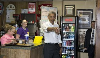 President Barack Obama talks to patrons after ordering lunch at Poor Boy Lloyd's in Baton Rouge, La., Thursday, Jan. 14, 2016. Earlier he spoke at McKinley Senior High School in Baton Rouge, La. (AP Photo/Carolyn Kaster)