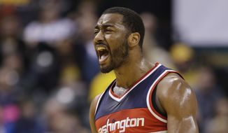 Washington Wizards' John Wall (2) celebrates during the second half of an NBA basketball game against the Indiana Pacers, Friday, Jan. 15, 2016, in Indianapolis. Washington won 118-104. (AP Photo/Darron Cummings)