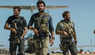 "This photo provided by Paramount Pictures shows Pablo Schreiber, from left, as Kris ""Tanto"" Paronto, John Krasinski as Jack Silva, David Denman as Dave ""Boon"" Benton and Dominic Fumusa as John ""Tig"" Tiegen, in the film, ""13 Hours: The Secret Soldiers of Benghazi"" from Paramount Pictures and 3 Arts Entertainment/Bay Films. The movie releases in U.S. theaters Jan. 15, 2016. (Christian Black/Paramount Pictures via AP)"