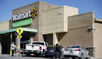 Shoppers leave the Wal-Mart Neighborhood Market in Dallas, Friday, Jan. 15, 2016. The Bentonville, Ark., company announced Friday the planned closure of 269 stores, more than half of them in the U.S. and another big chunk in its challenging Brazilian market. (Andy Jacobsohn/The Dallas Morning News via AP) MANDATORY CREDIT; MAGS OUT; TV OUT; INTERNET USE BY AP MEMBERS ONLY; NO SALES