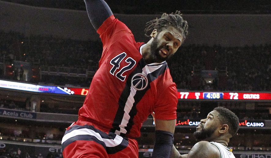 Washington Wizards center Nene (42), from Brazil, dunks the ball in front of Boston Celtics forward Amir Johnson (90) in the second half of an NBA basketball game, Saturday, Jan. 16, 2016, in Washington. The Celtics won 119-117. (AP Photo/Alex Brandon)