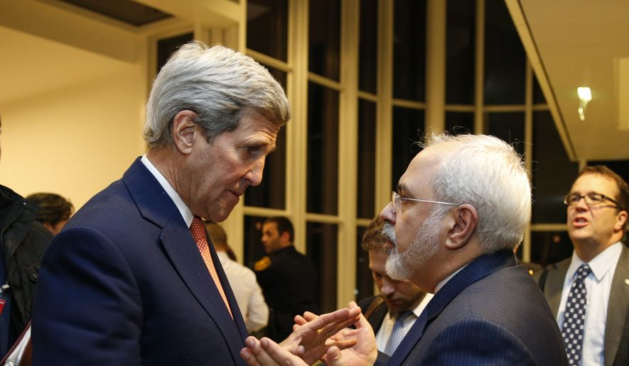 U.S. Secretary of State John Kerry talks with Iranian Foreign Minister Mohammad Javad Zarif, right, after the International Atomic Energy Agency (IAEA) verified that Iran has met all conditions under the nuclear deal, in Vienna, Saturday Jan. 16,  2016. (Kevin Lamarque/Pool via AP) ** FILE **