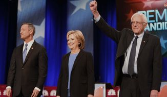 Democratic presidential candidates Martin O'Malley, Hillary Clinton and Bernard Sanders stand together before the start of the Democratic presidential debate Sunday at the Gaillard Center in Charleston, S.C. (Associated Press)
