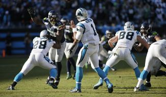 Carolina Panthers quarterback Cam Newton (1) passes against the Seattle Seahawks during the second half of an NFL divisional playoff football game, Sunday, Jan. 17, 2016, in Charlotte, N.C. (AP Photo/Chuck Burton)