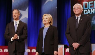 Democratic presidential candidate, former Maryland Gov. Martin O'Malley , left, Democratic presidential candidate, Hillary Clinton and Democratic presidential candidate, Sen. Bernie Sanders, I-Vt,  stand together before the start of the NBC, YouTube Democratic presidential debate at the Gaillard Center, Sunday, Jan. 17, 2016, in Charleston, S.C. (AP Photo/Mic Smith)