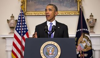 President Barack Obama speaks about the release of Americans by Iran, Sunday, Jan. 17, 2016, in the Cabinet Room of the White House in Washington. (AP Photo/Jacquelyn Martin)