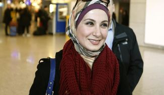 Sarah Hekmati, sister of Amir Hekmati, smiles as she arrives at the airport in Frankfurt, Germany, Monday, Jan. 18, 2016, the day after former US marine Amir Hekmati landed safely in Geneva and was transferred to Germany after being released from prison in Iran on Saturday.  (AP Photo/Michael Probst)
