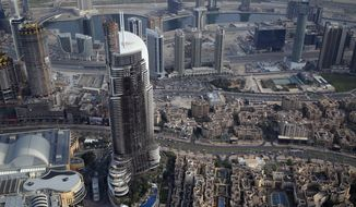 In this Sunday, Jan. 10, 2016, file photo, the burned hulk of The Address Downtown is seen in Dubai, United Arab Emirates. (AP Photo/Jon Gambrell)