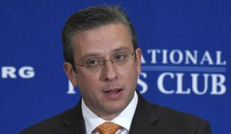"""In this Dec. 16, 2015 photo, Puerto Rico Gov. Alejandro Javier Garcia Padilla speaks at the National Press Club in Washington. Gov. Alejandro Garcia Padilla says that if Congress doesn't act soon, Puerto Rico is headed toward a """"humanitarian crisis under the United States flag."""" (AP Photo/Sait Serkan Gurbuz)"""