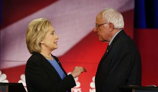 Democratic presidential candidate, Hillary Clinton and Democratic presidential candidate, Sen. Bernie Sanders, I-Vt. speak during a break at the NBC, YouTube Democratic presidential debate at the Gaillard Center, Sunday, Jan. 17, 2016, in Charleston, S.C. (AP Photo/Mic Smith) ** FILE **