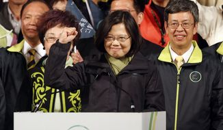 In this Saturday, Jan. 16, 2016 photo, Taiwan's Democratic Progressive Party, DPP, presidential candidate Tsai Ing-wen raises her hand as she declares victory in the presidential election, in Taipei, Taiwan. (AP Photo/Wally Santana, FIle)