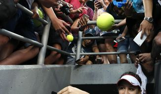Eugenie Bouchard of Canada takes a selfie for a fan after defeating Aleksandra Krunic of Serbia during their first round match at the Australian Open tennis championships in Melbourne, Australia, Monday, Jan. 18, 2016.(AP Photo/Shuji Kajiyama)