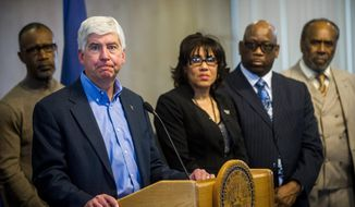 Michigan Gov. Rick Snyder speaks during a news conference in Flint, Mich., in this Jan. 11, 2016, file photo. The fallout from a water crisis in another impoverished city have marred the Republican's image as a practical problem-solver. (Jake May/The Flint Journal-MLive.com via AP, File)