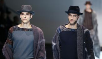 Models wear creations for Giorgio Armani men's Fall-Winter 2016-2017 collection, part of the Milan Fashion Week, unveiled in Milan, Italy, Tuesday, Jan. 19, 2016. (AP Photo/Antonio Calanni)
