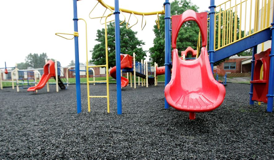 Ground-up recycled tire crumbs cover this playground behind the K-2nd grade elementary Dickerson School in Chester, N.J. (Associated Press)