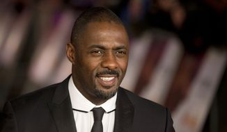 "In this Thursday, Dec. 5, 2013 file photo, British actor Idris Elba who plays Nelson Mandela in the movie ""Mandela: Long Walk to Freedom"", poses for photographers in London. In a speech Monday Jan. 18, 2016 told an audience at Parliament that Britain was successful, diverse and multicultural but a lack of diversity in films and television is not just an American problem. (AP Photo/Matt Dunham, File)"