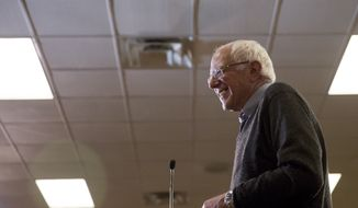 Democratic presidential candidate Sen. Bernie Sanders, I-Vt., smiles while speaking at a county meeting at U.M.B.A. Hall in Pottawattamie, Iowa, Tuesday, Jan. 19, 2016. (AP Photo/Andrew Harnik)