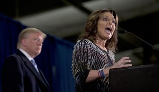 Former Alaska Gov. Sarah Palin, right, endorses  Republican presidential candidate Donald Trump during a rally at the Iowa State University, Tuesday, Jan. 19, 2016, in Ames, Iowa. (AP Photo/Mary Altaffer)