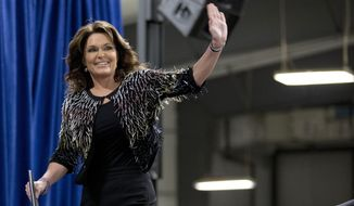 Former Alaska Gov. Sarah Palin waves as she arrives on stage to endorse Republican presidential candidate Donald Trump during a rally at the Iowa State University, Tuesday, Jan. 19, 2016, in Ames, Iowa. (AP Photo/Mary Altaffer) ** FILE **