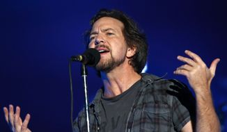 FILE - In this Sept. 26, 2015 file photo, Eddie Vedder of Pearl Jam performs at the Global Citizen Festival in New York. Pearl Jam, will join Stevie Wonder and Neil Young at this year's New Orleans Jazz and Heritage Festival at the Fair Grounds on the weekends of April 22-24 and April 28-May 1. (Photo by Greg Allen/Invision/AP, File)