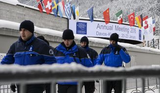 Swiss Police walk outside the congress center on the eve of the opening of the Annual Meeting of the World Economic Forum, WEF, in Davos, Switzerland, Tuesday, Jan. 19, 2016. (Jean-Christophe Bott/Keystone via AP)