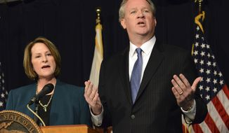Illinois House Republican Leader Jim Durkin, right, and Senate GOP Leader Christine Radogno speak at a news conference in Chicago, Wednesday, Jan. 20, 2016, where they called for a state takeover of the financially troubled Chicago Public Schools. They said the proposed legislation would give the Illinois State Board of Education control over the nation's third-largest school district. (Brian Jackson/Chicago Sun-Times via AP) CHICAGO TRIBUNE OUT, MANDATORY CREDIT, MAGS OUT, NO SALES