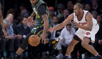 Utah Jazz forward Trevor Booker (33) strips the ball away from New York Knicks guard Arron Afflalo (4) during the second quarter of an NBA basketball game, Wednesday, Jan. 20, 2016, in New York. (AP Photo/Julie Jacobson)