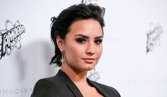 Singer Demi Lovato is among the celebrities hoping to boost Hillary Clinton's presidential campaign in Iowa. (Associated Press)