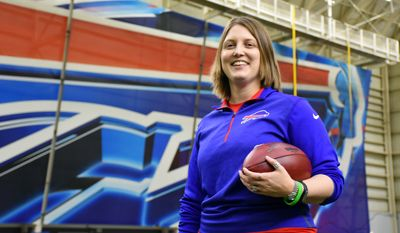 In this photo provided by the Buffalo Bills, Bills assistant football coach Kathryn Smith poses, Thursday, Jan. 21, 2016, in Orchard Park, N.Y. Smith is the first, full time, female assistant coach in the National Football League. (Anna Stolzenberg/Buffalo Bills via AP)