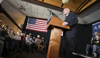 In this photo taken Tuesday, Jan. 19, 2016, Democratic presidential candidate Sen. Bernie Sanders, I-Vt., asks for support during the Feb. 1 Iowa Caucus during a campaign speech at Santa Maria Winery in Carroll, Iowa.  (Jeff Storjohann/Carroll Daily Times Herald via AP) MANDATORY CREDIT