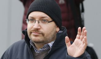 U.S. journalist Jason Rezaian waves as he poses for media people in front of Landstuhl Regional Medical Center in Landstuhl, Germany, Wednesday, Jan. 20, 2016. Rezaian was released from an Irani prison last Saturday. (AP Photo/Michael Probst)