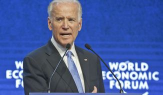 US Vice-President Joe Biden speaks at the plenary session of the World Economic Forum in Davos, Switzerland, Wednesday, Jan. 20, 2016. A prevailing sense of anxiety was in the air in the Swiss ski resort of Davos as the World Economic Forum kicked off Wednesday with delegates fretting about the turbulence in financial markets, slowdown in China and plunging oil prices. (AP Photo/Michel Euler)