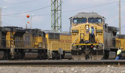In this Friday, June 6, 2014, photo, Union Pacific locomotives are seen in Council Bluffs, Iowa. Union Pacific reports quarterly earnings, Thursday, Jan. 21, 2016. (AP Photo/Nati Harnik)