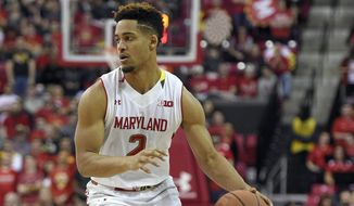 FILE - In this Jan. 16, 2016, file photo, Maryland guard Melo Trimble (2) dribbles the ball during the second half of an NCAA college basketball game against Ohio State, in College Park, Md. Trimble has broadened his game this season, often sacrificing points in favor of sharing the ball with his talented teammates.  (AP Photo/Nick Wass, File)