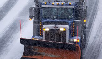 A snow plow and traffic make their way north along Interstate 95 as snow begins to fall in Ashland, Va., Friday, Jan. 22, 2016. Portions of Virginia are under a blizzard warning. (AP Photo/Steve Helber)
